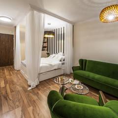 REALIZACJA - OLIMPIA PORT: styl , w kategorii Salon zaprojektowany przez Pracownie Wnętrz Kodo