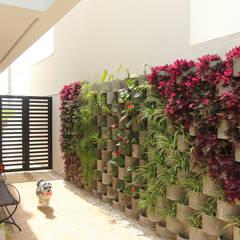 Casa AT: Jardins  por Taguá Arquitetura