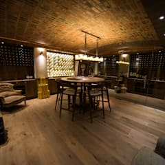 Upmarket home in Johannesburg:  Wine cellar by Kim H Interior Design,