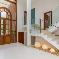 ระเบียงและโถงทางเดิน by Tammaro Arquitetura e Engenharia