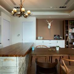 Dining room by 青瓷設計工程有限公司,