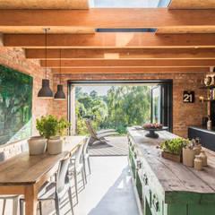 Miner's Cottage II:  Kitchen by design storey,