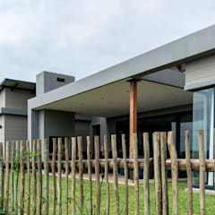 Modern family home in the heart of Simbithi Eco Estate:  Patios by CA Architects, Modern