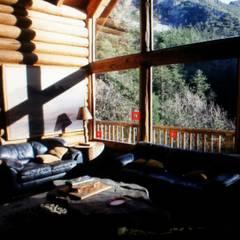 Cabaña Elite I: Salas de estilo  por nuk arquitech