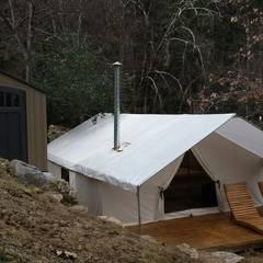 Cabaña Elite I: Terrazas de estilo  por nuk arquitech