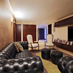 Casa 906: Salas de entretenimiento de estilo  por Objetos DAC