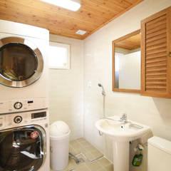 해질녘 노을이 아름다운 집: 꿈애하우징의  욕실