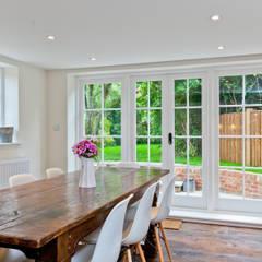 Japonica Cottage, Surrey :  Kitchen by Orchestrate Design and Build Ltd.