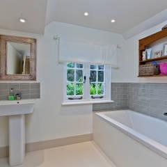 Baños de estilo  por Orchestrate Design and Build Ltd.