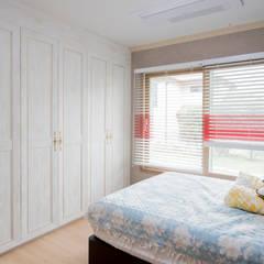 힐링이 되는, 제주도 목조주택: 꿈애하우징의  침실