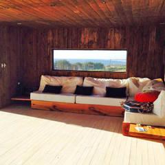 Casa Pangal: Livings de estilo  por Nido Arquitectos, Rústico