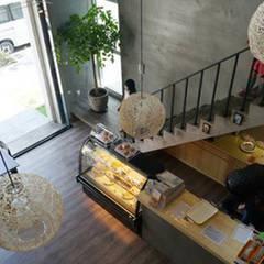 台南 金龍彩糕餅店 根據 直譯空間設計有限公司 簡約風