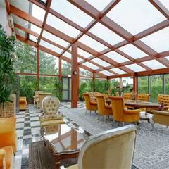 Jardines de invierno de estilo  por Inan AYDOGAN /IA  Interior Design Office