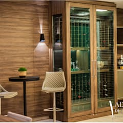 Wine cellar by Adriana Di Garcia Design de Interiores Ltda