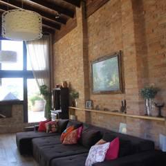غرفة المعيشة تنفيذ Barros e Zanolini Arquitetura e construção