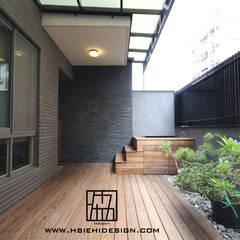 Varandas, marquises e terraços asiáticos por 協億室內設計有限公司 Asiático