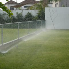 IRRIGATION SYSTEMS:  Garden by TARTE LANDSCAPES