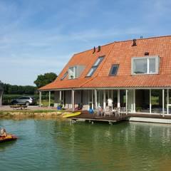 Vrijstaande woning in het landschap:  Jachten & jets door Architectenbureau Jules Zwijsen