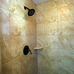 Bathroom uses Mosaic tile of Natural Stone:  Bathroom by Outer Banks Renovation & Construction
