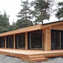 Beautiful Design Wooden House: modern Houses by Namas
