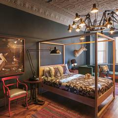 The Black House:  Bedroom by Etienne Hanekom Interiors