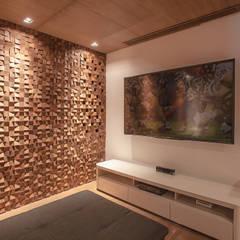 LAS OLAS: Salas multimedia de estilo  por Art.chitecture, Taller de Arquitectura e Interiorismo 📍 Cancún, México.