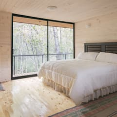Dormitorios rústicos de Ciclo Arquitectura Rústico Madera Acabado en madera