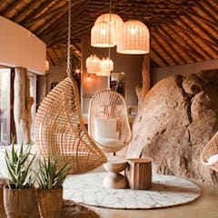 Madikwe Hills informal lounge:  Hotels by Nowadays Interiors