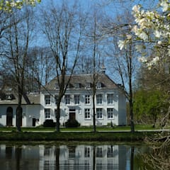 Villa Marlot: rustieke & brocante Huizen door DYLUNIO | architectuur & interieur
