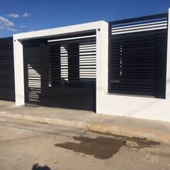 FACHADA MINIMALISTA: Casas de estilo  por Arq. Alberto Quero