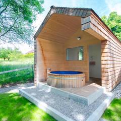 Spa de estilo  por w. raum Architektur + Innenarchitektur