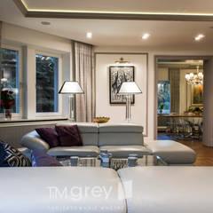 300m2 of classic elegance.: styl , w kategorii Salon zaprojektowany przez TiM Grey Interior Design