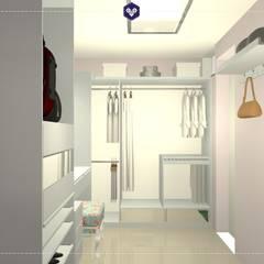 Vista do closet 1: Closets ecléticos por Kestie Arquitetura
