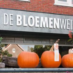 Herinrichting en nieuwe uitstraling voor De Bloemenweide in Haarlem:  Winkelruimten door Ien Interieurontwerp Advies Projectbegeleiding