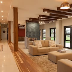 House Naidoo: modern Living room by Redesign Interiors