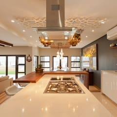 House Naidoo: modern Kitchen by Redesign Interiors