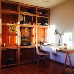 Oficina Taller Independiente Arquitectura & Diseño: Estudios y biblioteca de estilo  por Taller Independiente - Arquitectura & Diseño