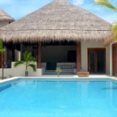 Hoteles de estilo  por sandro bortot arquitecto, Tropical