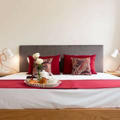 Cama: Hotéis  por Alma Braguesa Furniture