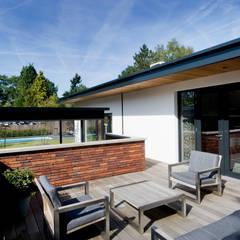 Doordachte lounge. : moderne Tuin door Heart for Gardens.