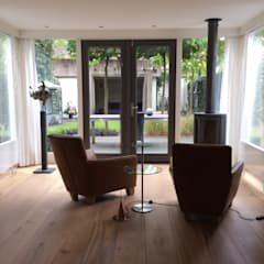 Uitbreiding Villa in Laren, 2 troeven in 1:  Serre door Studio Inside Out