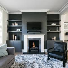Living room by Grand Design London Ltd