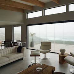 Brenton House living room 02:  Living room by Sergio Nunes Architects