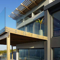 Brenton on Sea:  Houses by Sergio Nunes Architects, Modern Granite