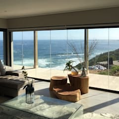 Brenton on Sea:  Living room by Sergio Nunes Architects