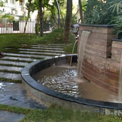 water fountain :  Commercial Spaces by Land Design landscape architects,