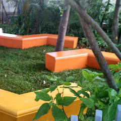 Colourful sitting area:  Commercial Spaces by Land Design landscape architects,