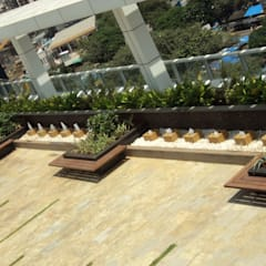 seats with planters:  Commercial Spaces by Land Design landscape architects