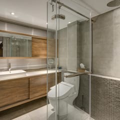 Bathroom by 齊禾設計有限公司