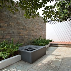 water feature:  Garden by Land Design landscape architects